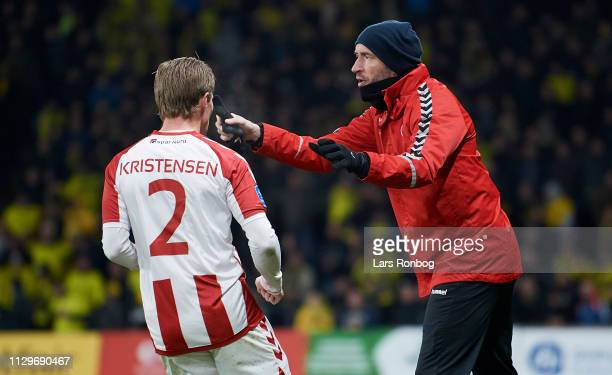 Jacob Friis head coach of AaB Aalborg speaks to Patrick Kristensen of AaB Aalborg during the Danish Superliga match between Brondby IF and AaB...