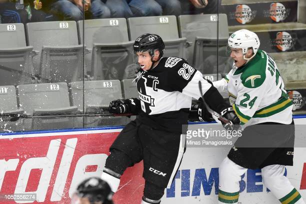 Jacob Gaucher of the ValdOr Foreurs holds back Alexander Katerinakis of the BlainvilleBoisbriand Armada during the QMJHL game at Centre d'Excellence...