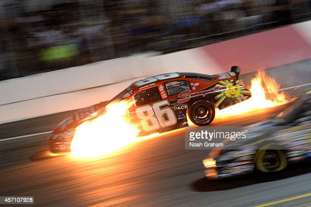 Jacob Gomes driver of the Sunny Valley Meats Chevrolet on fire during the NASCAR KN Toyota/NAPA Auto Parts 150 at the All American Speedway on...