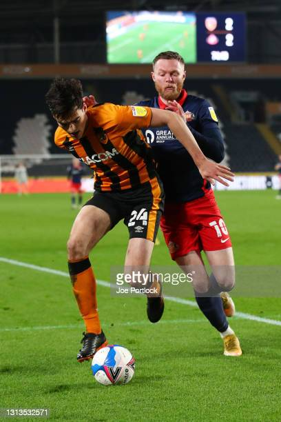 Jacob Greaves of Hull City and Aiden O'Brien of Sunderland during the Sky Bet League One match between Hull City and Sunderland at KCOM Stadium on...
