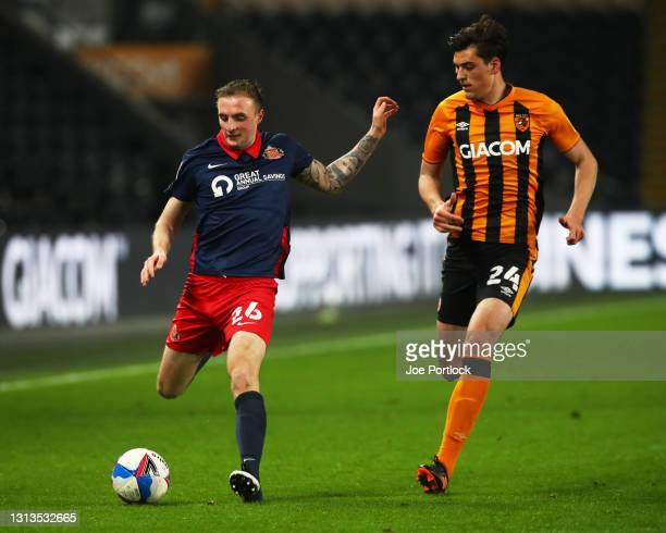 Jacob Greaves of Hull City and Carl Winchester of Sunderland during the Sky Bet League One match between Hull City and Sunderland at KCOM Stadium on...