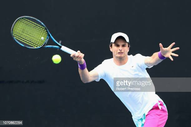 Jacob Grills plays a forehand in his match against Akira Santillan during the 2019 Australian Open Playoff match at Melbourne Park on December 10...