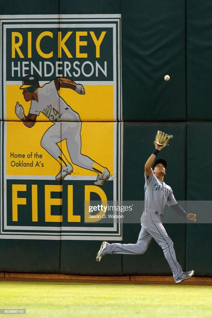 Jacob Hannemann #13 of the Seattle Mariners catches a fly ball hit off the bat of Jake Smolinski (not pictured) of the Oakland Athletics during the sixth inning at the Oakland Coliseum on September 25, 2017 in Oakland, California. The Seattle Mariners defeated the Oakland Athletics 7-1.