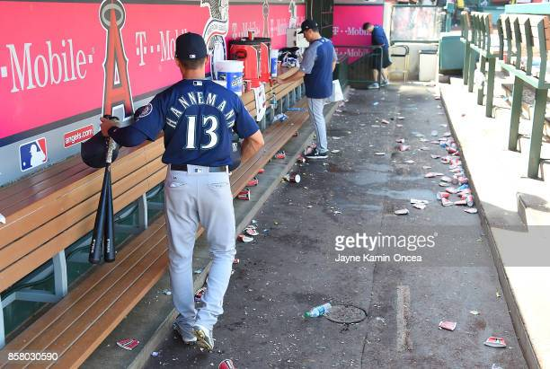 Jacob Hannemann of the Seattle Mariners gathers his gear from the dugout after the final out of the season in the game against the Los Angeles Angels...