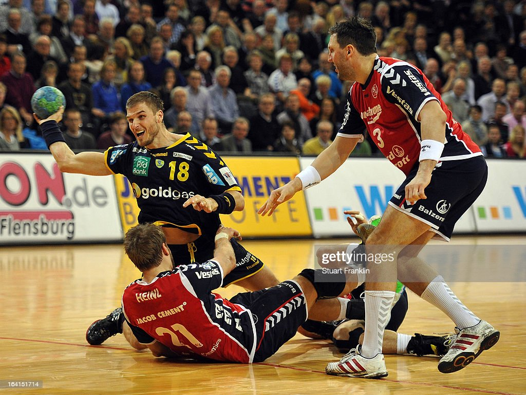 Jacob Henri of Flensburg challenges Bjarte Myrhol of Rhein-Neckar during the Toyota Bundesliga handball game between SG Flensburg-Handewitt and Rhein-Neckar Loewen at the Flens arena on March 20, 2013 in Flensburg, Germany.