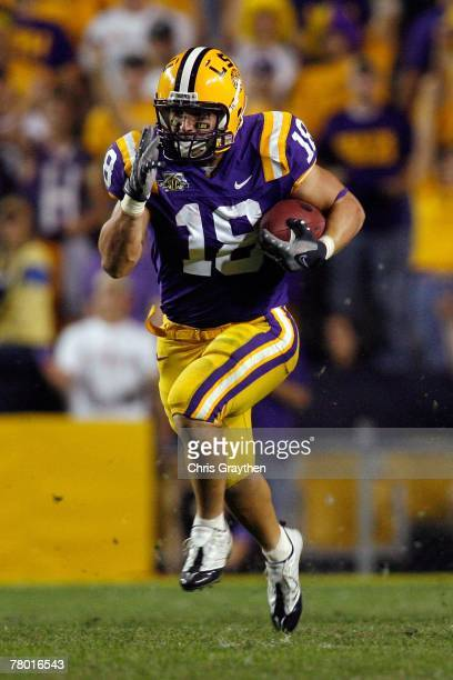 Jacob Hester of the Louisiana State University Tigers runs past Weldon Brown of the Louisiana Tech Bulldogs on his way to scoring an 87 yard...