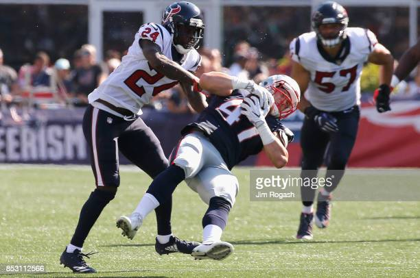 Jacob Hollister of the New England Patriots is tackled by Johnathan Joseph of the Houston Texans during the third quarter of a game at Gillette...