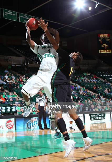 Jacob Holmen of the North Texas Mean Green shoots against Antonnio Benton of the Southeastern Louisiana Lions at the UNT Coliseum on December 16 2012...