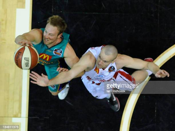 Jacob Holmes of the Crococdiles contests the ball with Larry Davidson of the Hawks during the round nine NBL match between the Townsville Crocodiles...