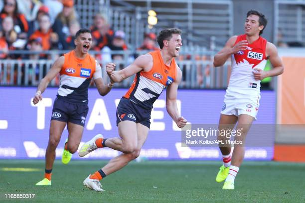 Jacob Hopper of the Giants celebrates kicking a goal during the round 20 AFL match between the Greater Western Sydney Giants and the Sydney Swans at...