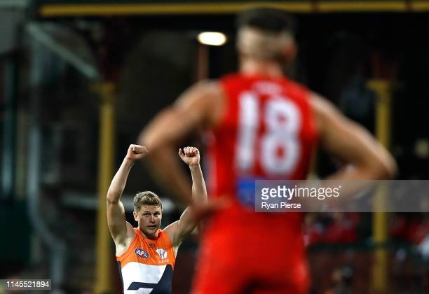 Jacob Hopper of the Giants celebrates on the siren during the round 6 AFL match between the Sydney Swans and GWS Giants at Sydney Cricket Ground on...