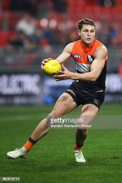 Jacob Hopper of the Giants runs during the round 10 AFL match between the Greater Western Sydney Giants and the Essendon Bombers at Spotless Stadium...