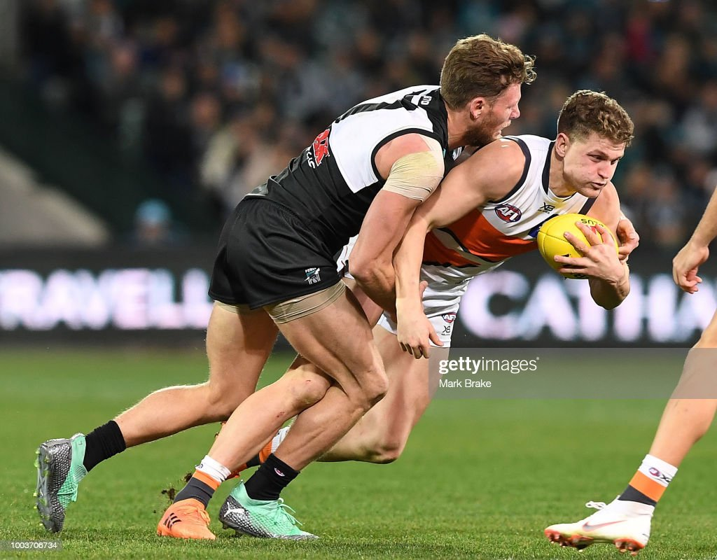 Jacob Hopper of the Giants tackled by Brad Ebert of Port Adelaide during the round 18 AFL match between the Port Adelaide Power and the Greater Western Sydney Giants at Adelaide Oval on July 22, 2018 in Adelaide, Australia.