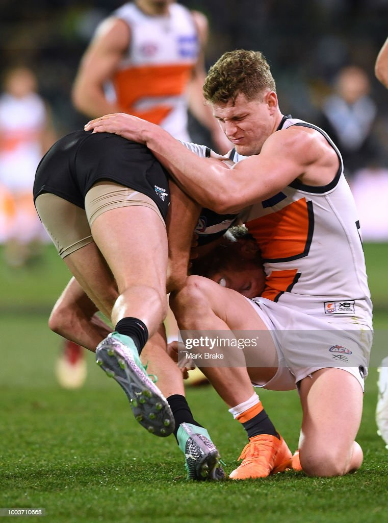 Jacob Hopper of the Giants tackles Brad Ebert of Port Adelaide during the round 18 AFL match between the Port Adelaide Power and the Greater Western Sydney Giants at Adelaide Oval on July 22, 2018 in Adelaide, Australia.