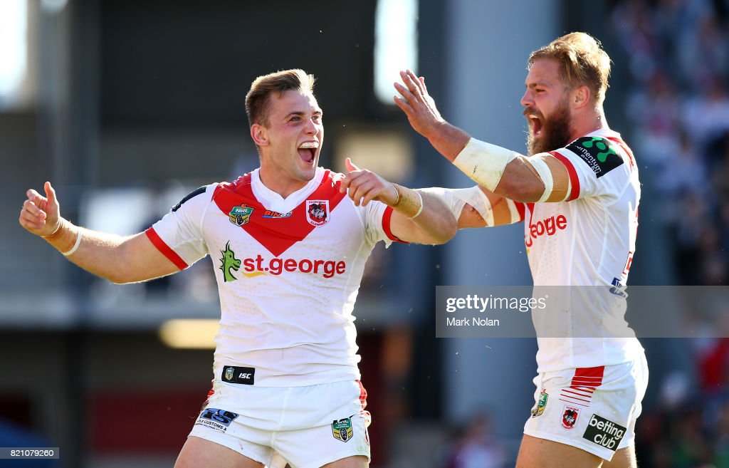 Jacob Host of the Dragons celebrates with team mate Jack De Belin after scoring during the round 20 NRL match between the St George Illawarra Dragons and the Manly Sea Eagles at WIN Stadium on July 23, 2017 in Wollongong, Australia.