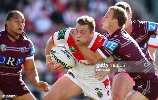Jacob Host of the Dragons is tackled during the round 20 NRL match between the St George Illawarra Dragons and the Manly Sea Eagles at WIN Stadium on...
