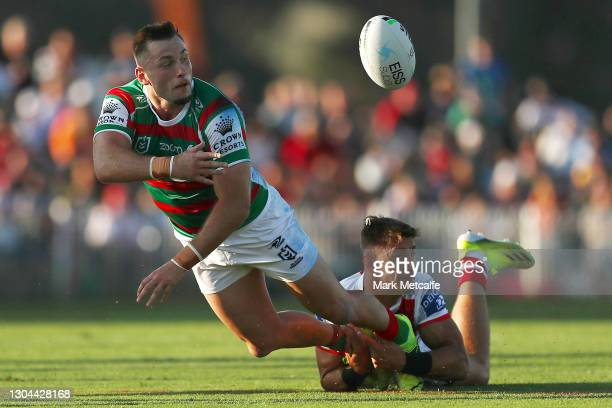 Jacob Host of the Rabbitohs offloads during the Charity Shield & NRL Trial Match between the South Sydney Rabbitohs and the St George Illawarra...