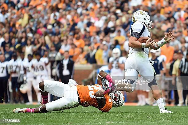 Jacob Huesman of the Chattanooga Mocs is brought down by Cameron Sutton of the Tennessee Volunteers during a game at Neyland Stadium on October 11...