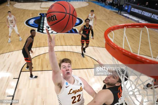 Jacob Hutson of the Loyola-Chicago Ramblers shoots over Roman Silva of the Oregon State Beavers during the first half in the Sweet Sixteen round of...