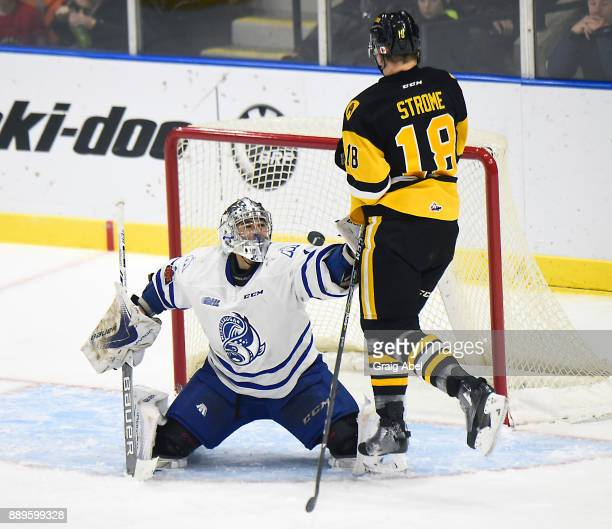 Jacob Ingham of the Mississauga Steelheads stops a shot against Matthew Strome of the Hamilton Bulldogs during game action on December 10 2017 at...