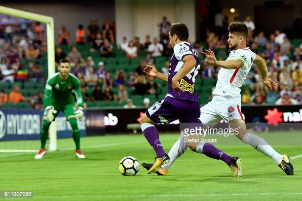 Jacob Italiano of the Glory and Brendan Hamill of the Wanderers contest the ball during the round 18 ALeague match between the Perth Glory and the...