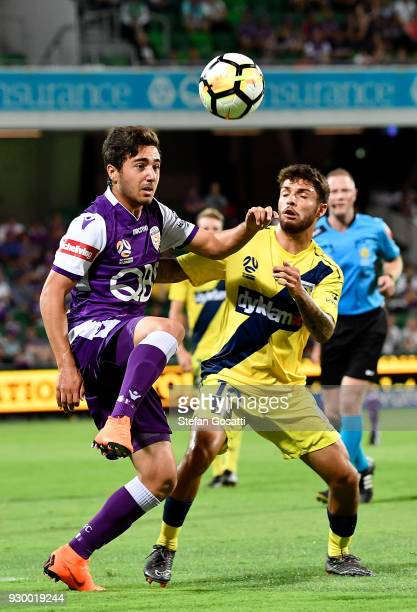 Jacob Italiano of the Glory and Danny De Silva of the Mariners contest the ball during the round 22 ALeague match between the Perth Glory and the...