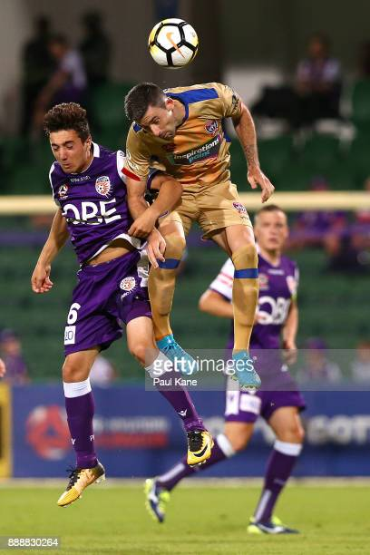 Jacob Italiano of the Glory and Jason Hoffman of the Jets contest a header during the round 10 ALeague match between the Perth Glory and the...