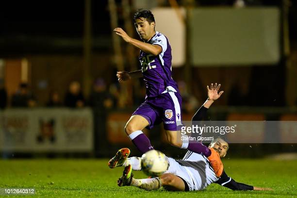 Jacob Italiano of the Glory and Terry Antonis of the Victory compete for the ball during the FFA Cup round of 32 match between Perth Glory and...
