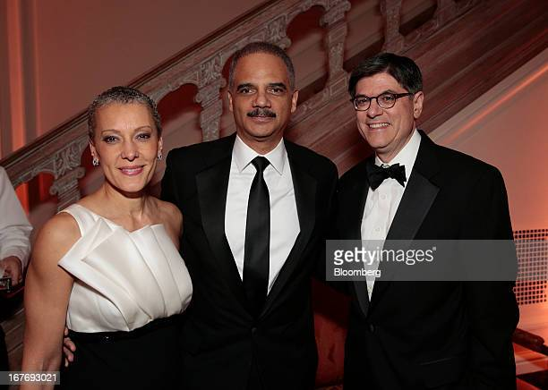 Jacob Jack Lew US treasury secretary from right Eric Holder US attorney general and his wife Sharon Malone attend the Bloomberg Vanity Fair White...