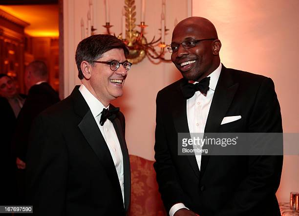 Jacob Jack Lew US treasury secretary left and Reggie Love former assistant to US President Barack Obama attend the Bloomberg Vanity Fair White House...