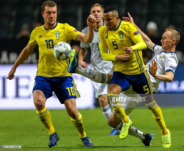 Jacob Johansson , Martin Olsson of Sweden and Vladislav Ignatyev of the Russia vie for the ball during the UEFA Nations League B group two match...