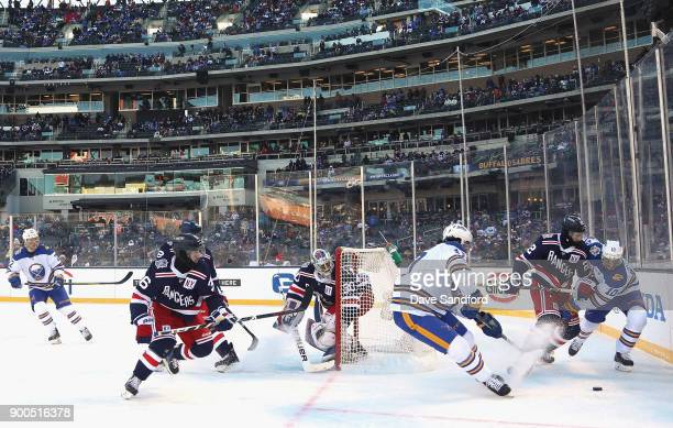 Jacob Josefson of the Buffalo Sabres and Kevin Shattenkirk of the New York Rangers plays in the 2018 Bridgestone NHL Winter Classic at Citi Field on...