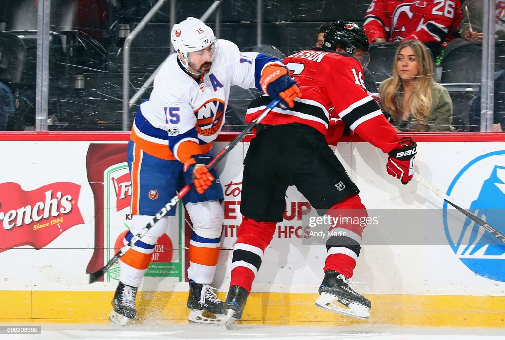 Jacob Josefson #16 of the New Jersey Devils and Cal Clutterbuck #15 of the New York Islanders come together at the boards during the game at Prudential Center on April 8, 2017 in Newark, New Jersey. Photo by Andy Marlin/NHLI via Getty Images)