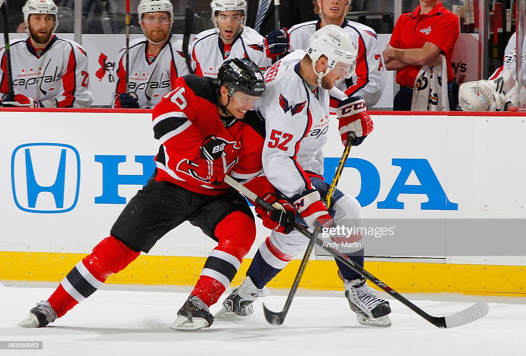 Jacob Josefson #16 of the New Jersey Devils and Mike Green #52 of the Washington Capitals battle for position during the game at the Prudential Center on April 4, 2014 in Newark, New Jersey.