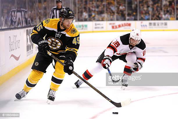 Jacob Josefson of the New Jersey Devils defends Joe Morrow of the Boston Bruins during the first period at TD Garden on October 20 2016 in Boston...