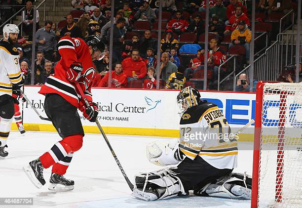 Jacob Josefson of the New Jersey Devils shoots against Niklas Svedberg of the Boston Bruins during their game at the Prudential Center on February 27...