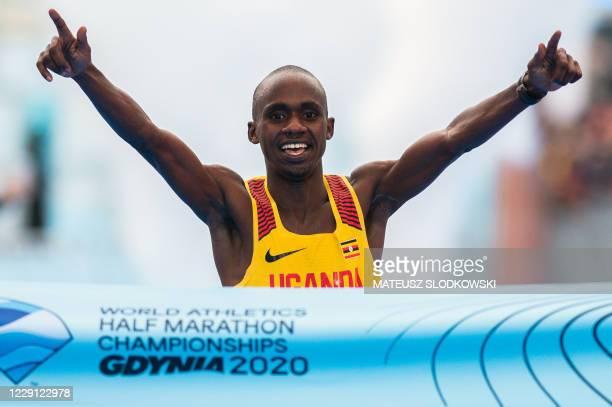 Jacob Kiplimo of Uganda celebrates winning the men's race of the 2020 IAAF World Half Marathon Championships in Gdynia Poland in October 17 2020