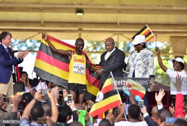 Jacob Kiplimo of Uganda celebrates with President of Uganda Yoweri Kaguta Museveni after winning the U20 men's race during the 27th World Cross...