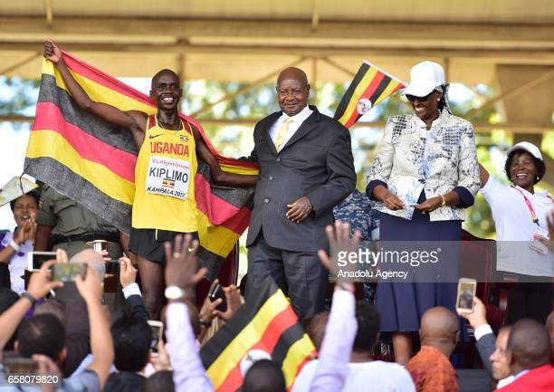 Jacob Kiplimo of Uganda celebrates with President of Uganda Yoweri Kaguta Museveni after winning the U20 men's race during the 27th World Cross...
