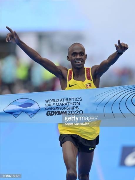 Jacob Kiplimo of Uganda crosses the finish line to win the Men's Final Race during the World Athletics Half Marathon Championships on October 17,...