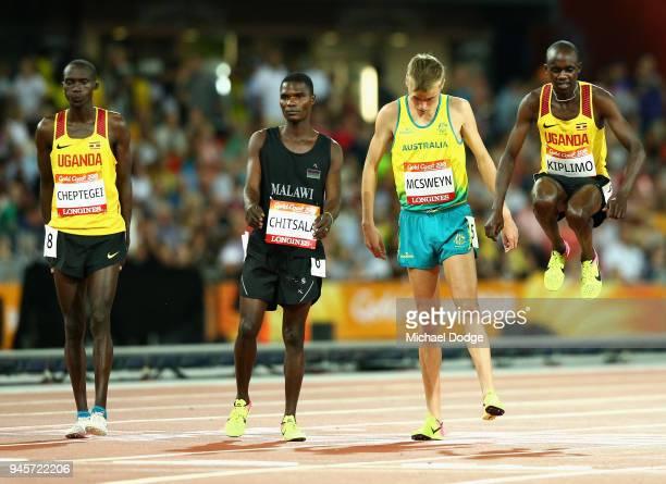 Jacob Kiplimo of Uganda jumps alongside Stewart McSweyn of Australia prior to the Men's 10000 metres final during athletics on day nine of the Gold...