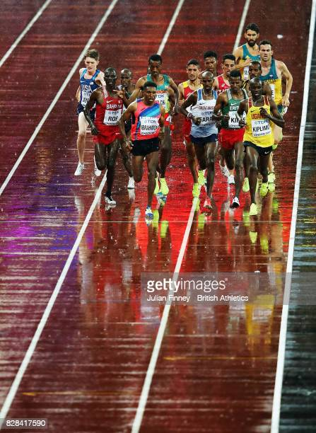 Jacob Kiplimo of Uganda leads during heat one of the Men's 5000 Metres heats Mohamed Farah of Great Britain during day six of the 16th IAAF World...