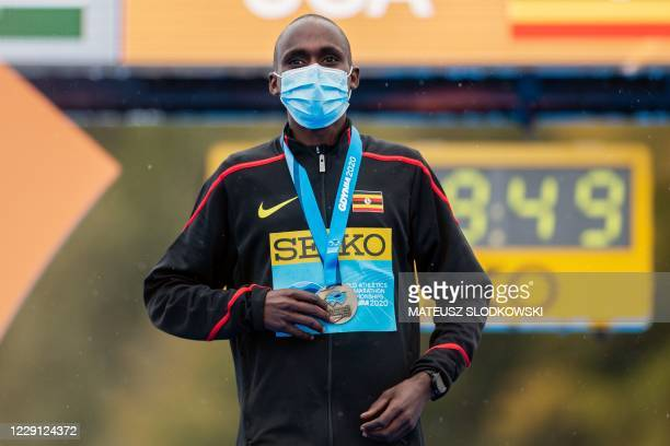 Jacob Kiplimo of Uganda poses with his gold medal on the podium after winning the men's race of the 2020 IAAF World Half Marathon Championships in...