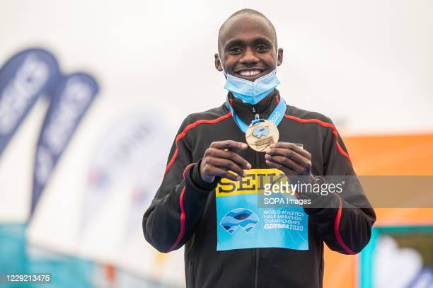 Jacob Kiplimo of Uganda with a gold medal of 2020 IAAF World Half Marathon Championships in Gdynia.