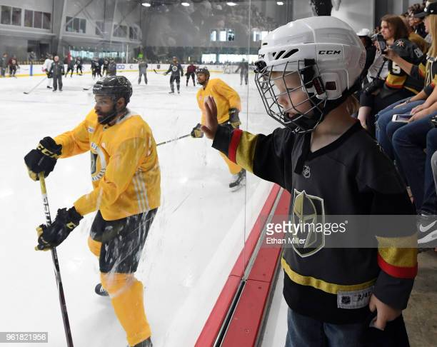 Jacob Kotter of Nevada watches Vegas Golden Knights players including PierreEdouard Bellemare and Ryan Reaves hold their first practice since winning...