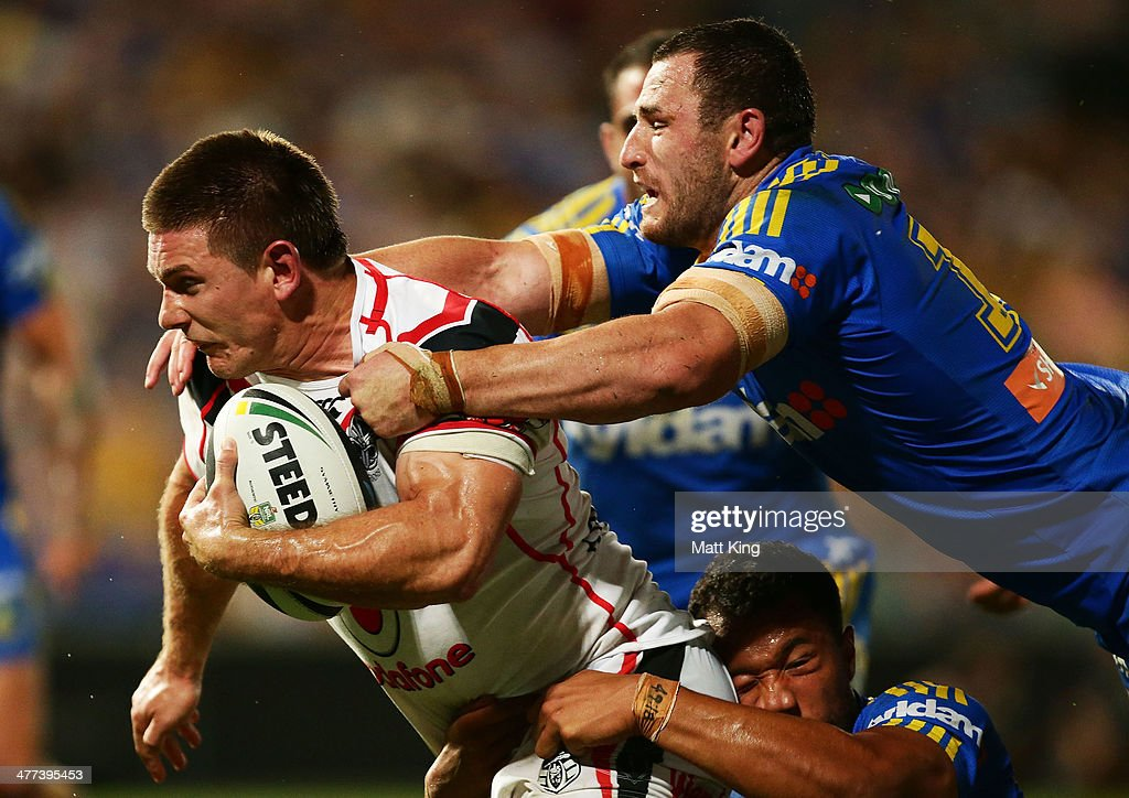 Jacob Lillyman of the Warriors is tackled from behind by Ben Smith of the Eels during the round one NRL match between the Parramatta Eels and the New Zealand Warriors at Pirtek Stadium on March 9, 2014 in Sydney, Australia.