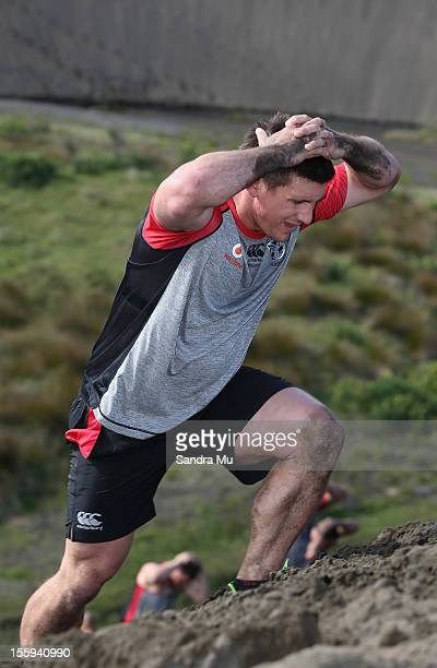 Jacob Lillyman of the Warriors trains on the sand dunes during the New Zealand Warriors NRL training session at Bethells Beach on November 10 2012 in...