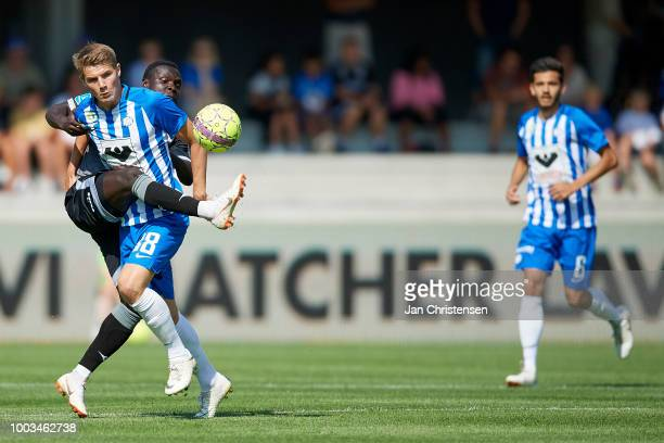 Jacob Lungi Sorensen of Esbjerg fB and Moses Opondo of Vendsyssel FF compete for the ball during the Danish Superliga match between Esbjerg fB and...