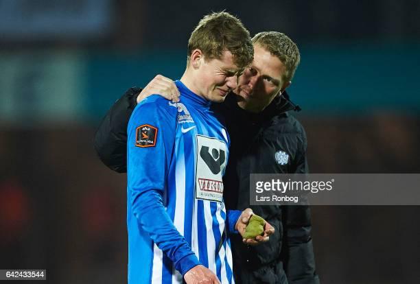 Jacob Lungi Sorensen of Esbjerg fB leaving the pitch injured during the Danish Alka Superliga match between Esbjerg fB and Sonderjyske at Blue Water...