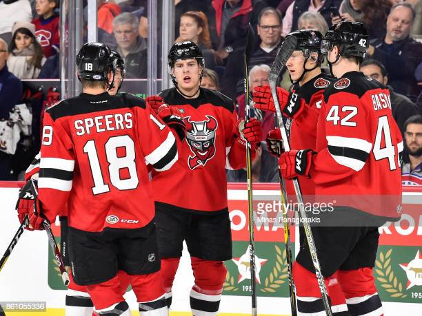 Jacob MacDonald of the Binghamton Devils celebrates a first period goal with teammates against the Laval Rocket during the AHL game at Place Bell on...
